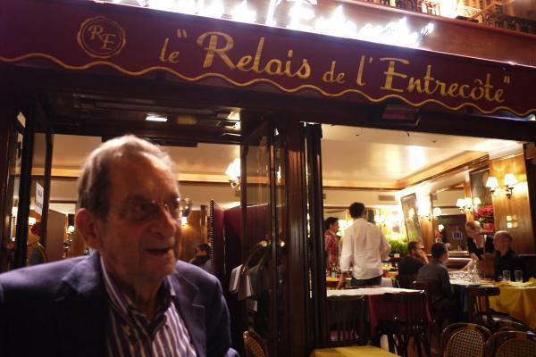 Juri leaves his favourite steak restaurant in Paris